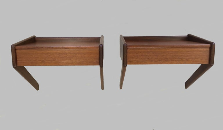 1960s set of two Danish Sigfred Omann floating nightstands in teak by Oelholm  A pair of floating nightstands or shelves in teak, each with a single drawer, designed by Sigfred Omann for Ølholm Møbelfabrik   The nightstands have been checked and