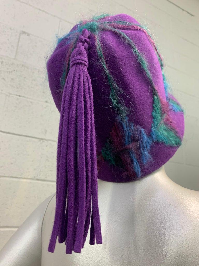1960s Schiaparelli purple wool felt bucket hat with high crown, multi-color yarn embroidery and long felt tassel at crown. Size Medium.