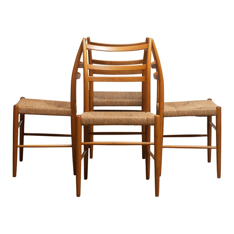Extremely rare and beautiful set of four slim seagrass chairs in beech, model 'Gracell' designed by Yngve Ekström and manufactured by Gemla. All four chairs are in very good condition. The wicker seats are made of seagrass and are also in great