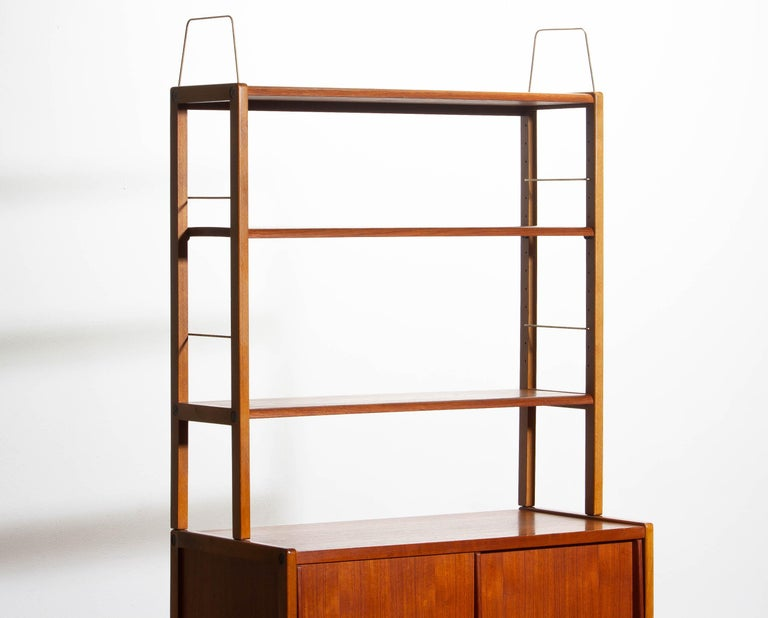 Swedish 1960, Teak, Brass and Beech Bookcase by Bertil Fridhagen for Bodafors, Sweden For Sale