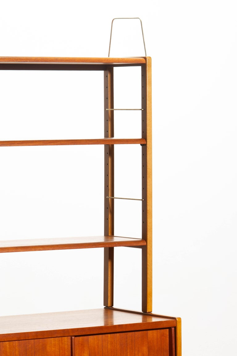 Mid-20th Century 1960, Teak, Brass and Beech Bookcase by Bertil Fridhagen for Bodafors, Sweden For Sale