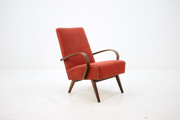 This chair was made in Czech Republic during 1960s by Thon company (before Thonet). Legs and bentwood armrests are made from beech wood and have been re-polished. Good original fabric upholstery with no holes.