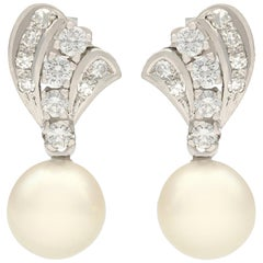 1960s 1.05 Carat Diamond and Cultured Pearl White Gold Drop Earrings