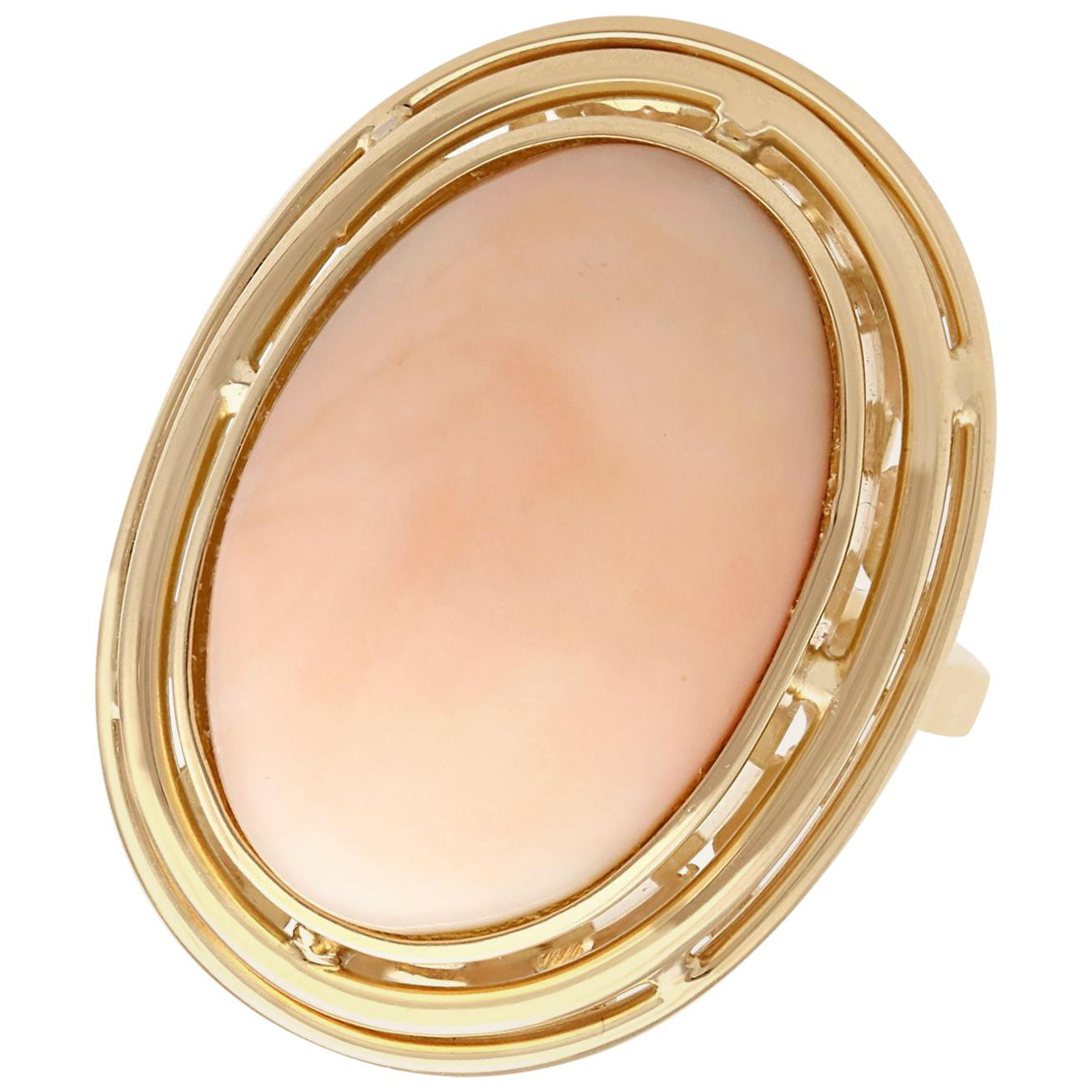 1960s 13.98 Carat Cabochon Cut Coral and Yellow Gold Cocktail Ring