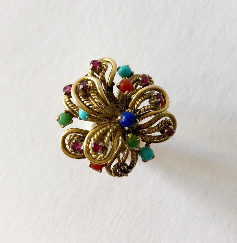 Multi gemstone ring set in 14K gold, possibly Italian circa 1960's.  Ring is a finger size 6  and is signed 14k.  In very good vintage condition.  10.9 grams.