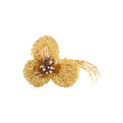 1960s 18 Karat Yellow Gold Flower with Ruby and Diamonds Brooch