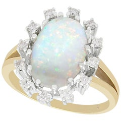 1960s 3.01 Carat Opal and Diamond Yellow Gold Cocktail Ring