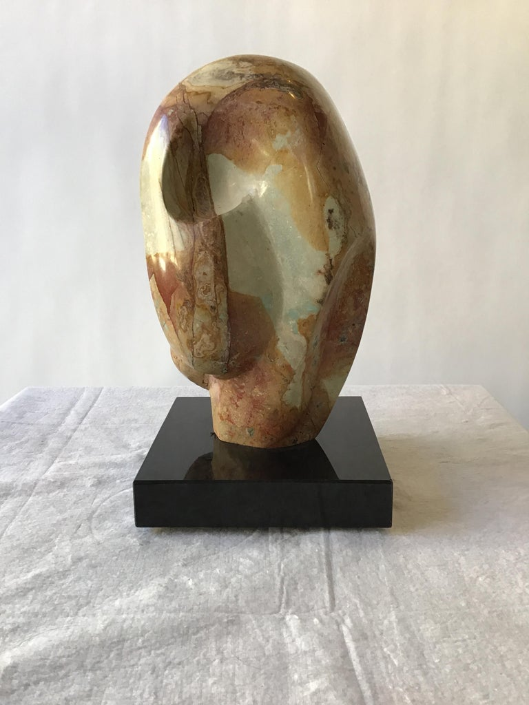 1960s abstract carved marble sculpture on revolving granite base.