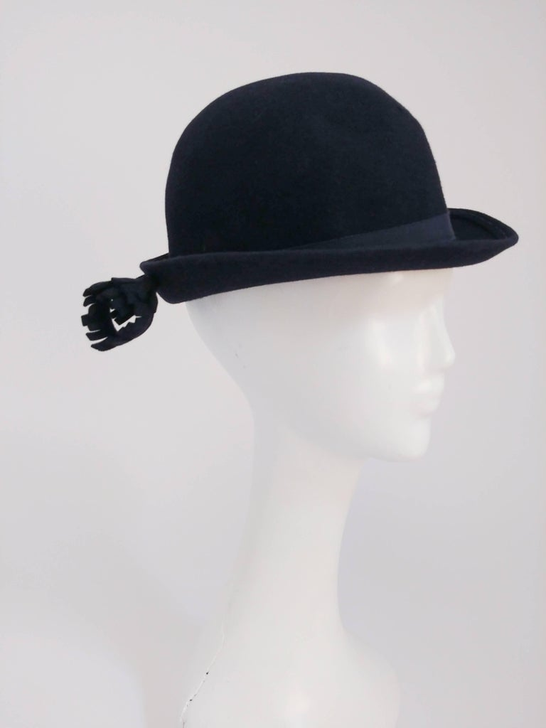 1960s Adolfo Navy Hat with Flower Accent. Navy Adolfo II for I. Magnin cashmere felt hat with grosgrain band and handmade flower accent near the back of the brim. 22+ inch circumference.