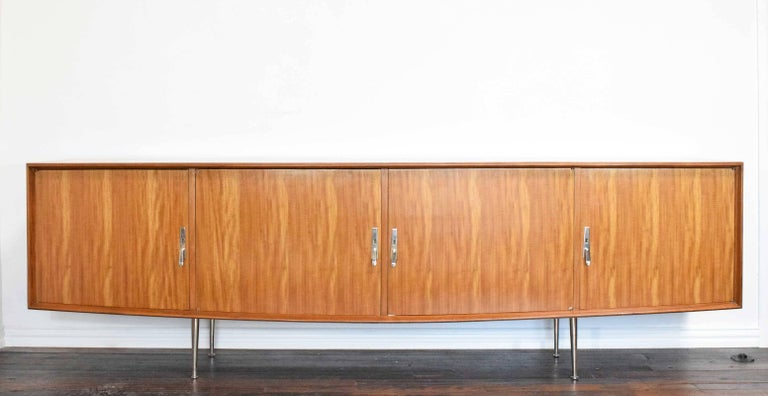 Beautifully restored, four doors, one section has a mirror on the inside. We will add shelves. Sits on chrome legs with drop chromed hardware. Has a very nice rounded edge detail around face of cabinet. Very elegant stand out piece, well crafted.