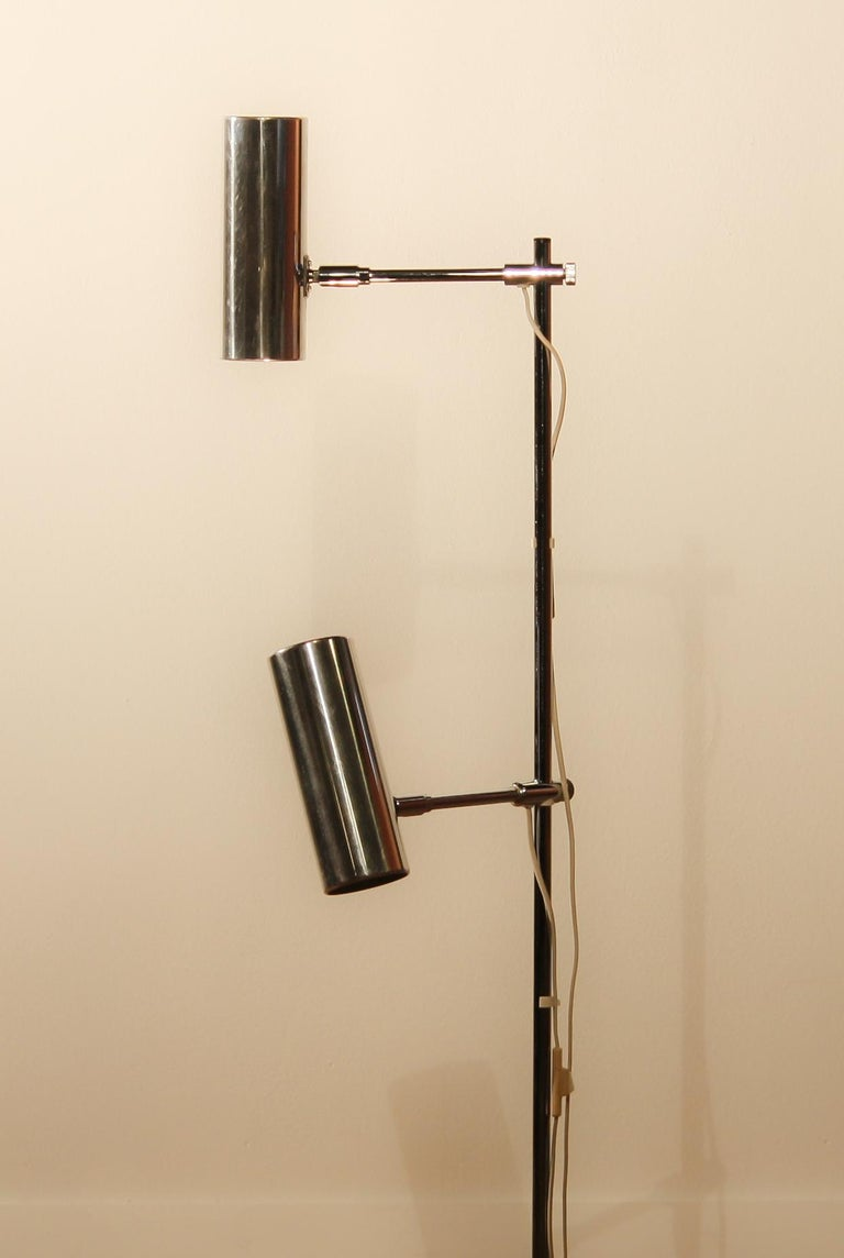 Beautiful floor lamp made by Bergboms scan light AB, Sweden. This lamp has two-light. The lampshades are made of aluminum and the Stand is made of chromed steel. It is in a nice working condition. Period: 1960s. Dimensions: H 112 cm, ø 23