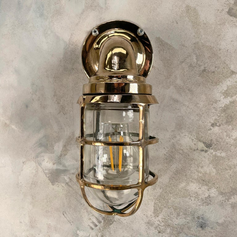 Industrial 1960s American Paulhuhn Crouse-Hinds Bronze 90 Degree Sconce, Cage & Glass Dome For Sale