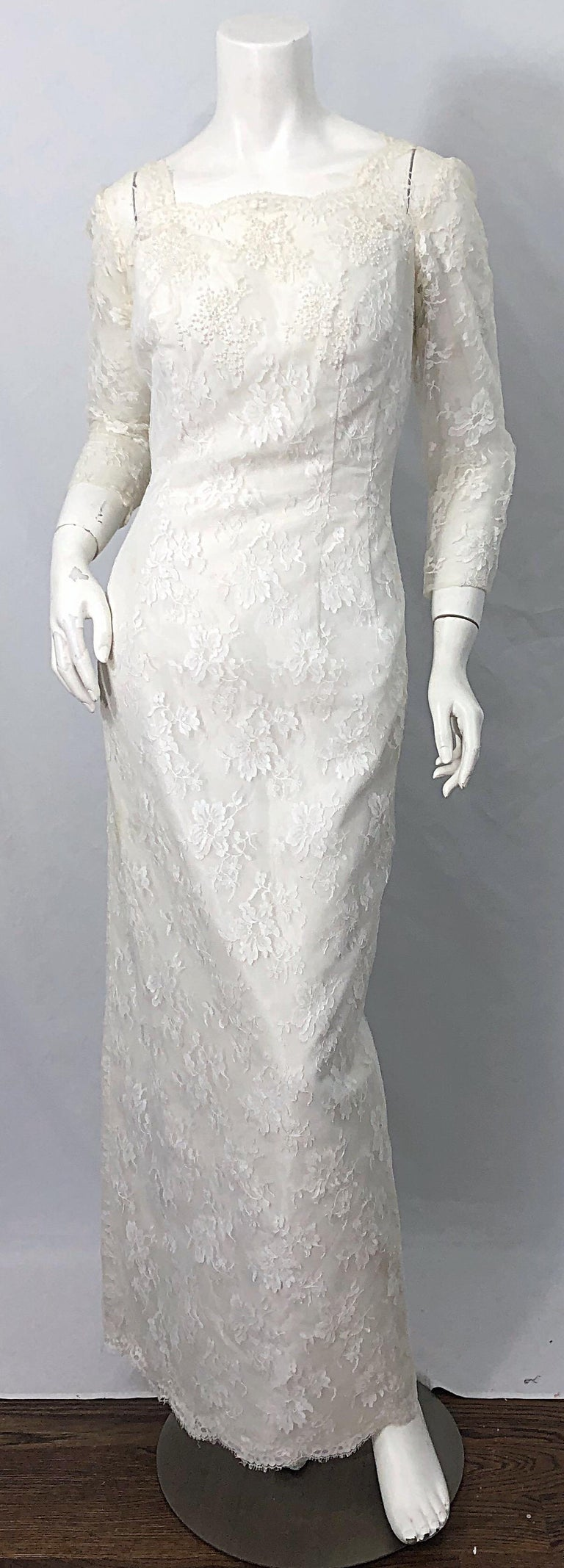 Beautiful early 60s AN ORIGINAL BY CONSTANTINO white beaded, sequin, pearl long sleeve silk lace wedding dress ! Couture quality, with so much attention to details. Silk taffeta with white French lace overlay. Thousands of hand-sewn beads and