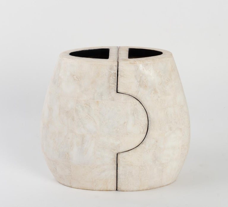 Beautiful set of 2 enameled porcelain stoneware vases. The rotund shapes and soft lines give to this two vases which stack together a look of gentle characters.   Andree and Michel Hirlet are two renowned ceramists working and living together,