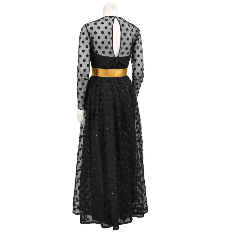 1960s Anonymous Black Long Sleeve Gown with Polka Dot Net Overlay and Gold Sash  In Good Condition For Sale In Toronto, Ontario