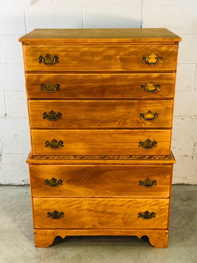 """Vintage 1960s tall maple wood dresser by Baumritter - Ethan Allen. The dresser is from the Colonial series and has six drawers for storage. Drawers range from 4"""" to 7"""" in height. The drawers are brass and the dresser is marked in the drawer."""