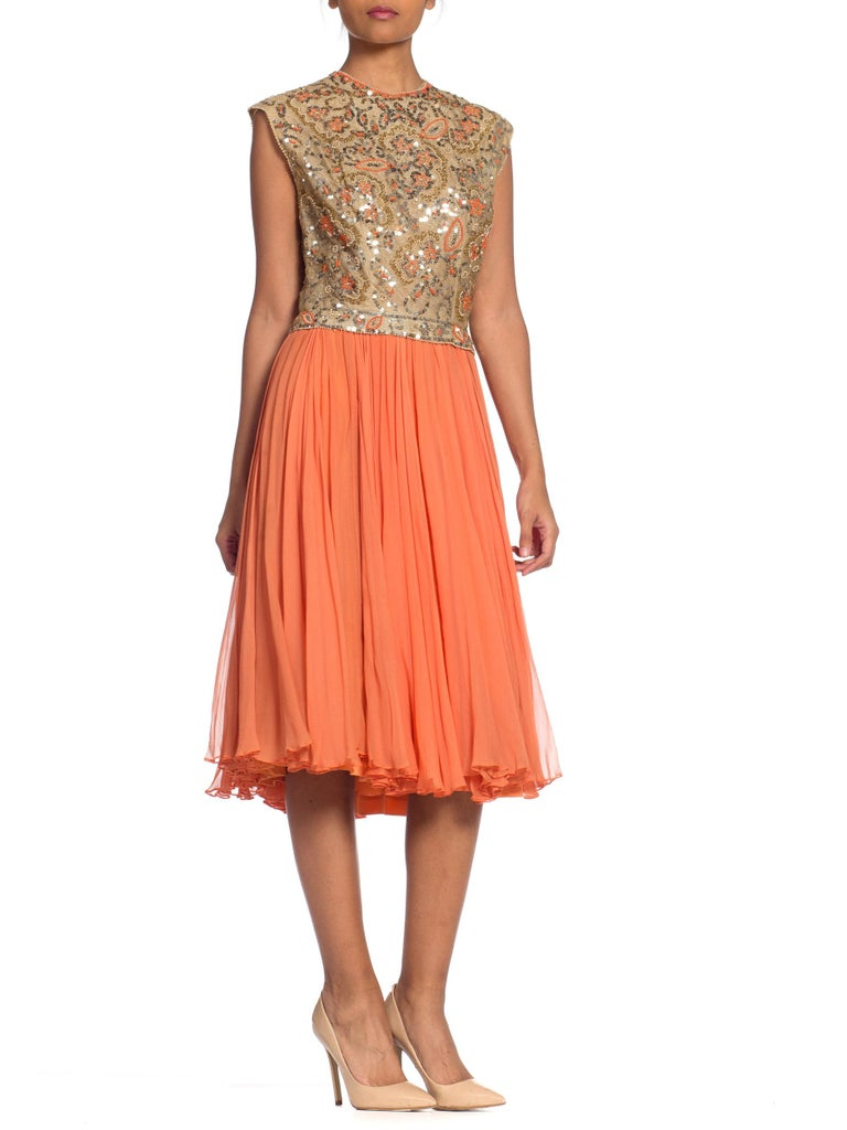 Early 1960s full flare silk chiffon dress with a gold net bodice covered in beads and sequins. Our model is a size 4 and the dress is a little loose on her, please note measurements.