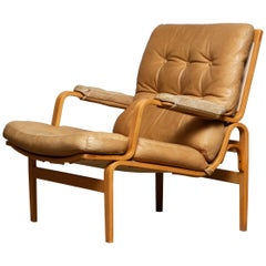 1960s, Beech and Leather Lounge / Easy Chair by Bruno Mathsson for DUX in Camel