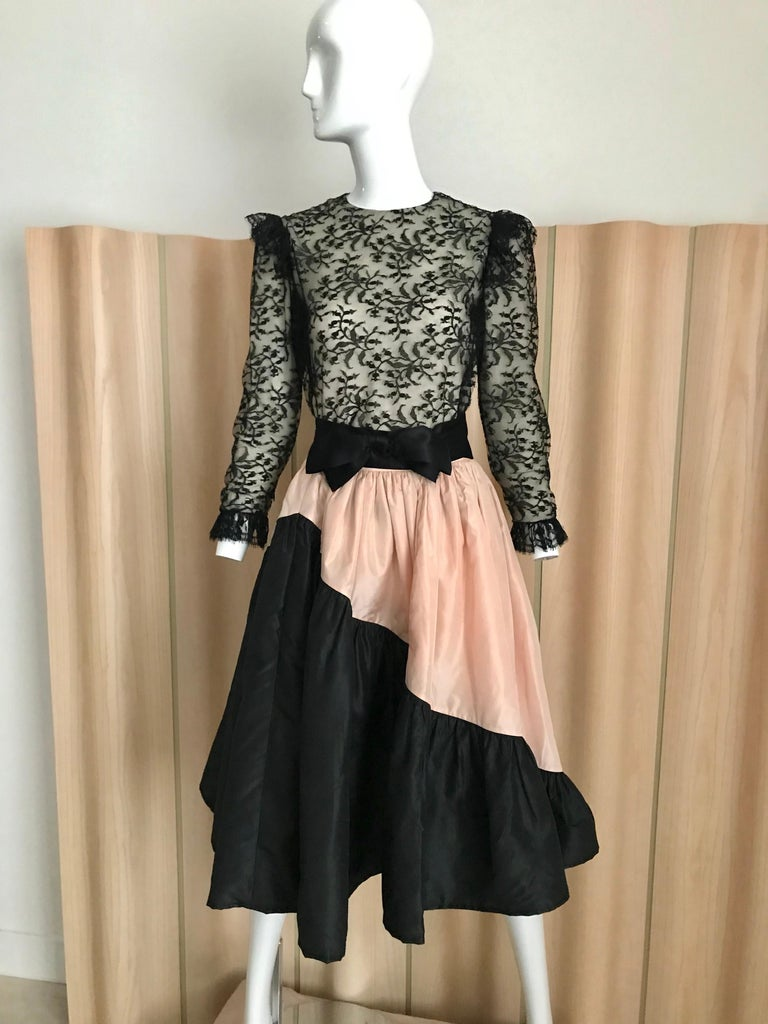 Vintage 60s Bill Blass black lace silk blouse with ruffle on the shoulder.  This two piece comes with  pink and black silk taffeta circle skirt and silk sash bow.   Blouse is best for petite size. Sleeve is rather shorter than usual. Bust Blouse: 32