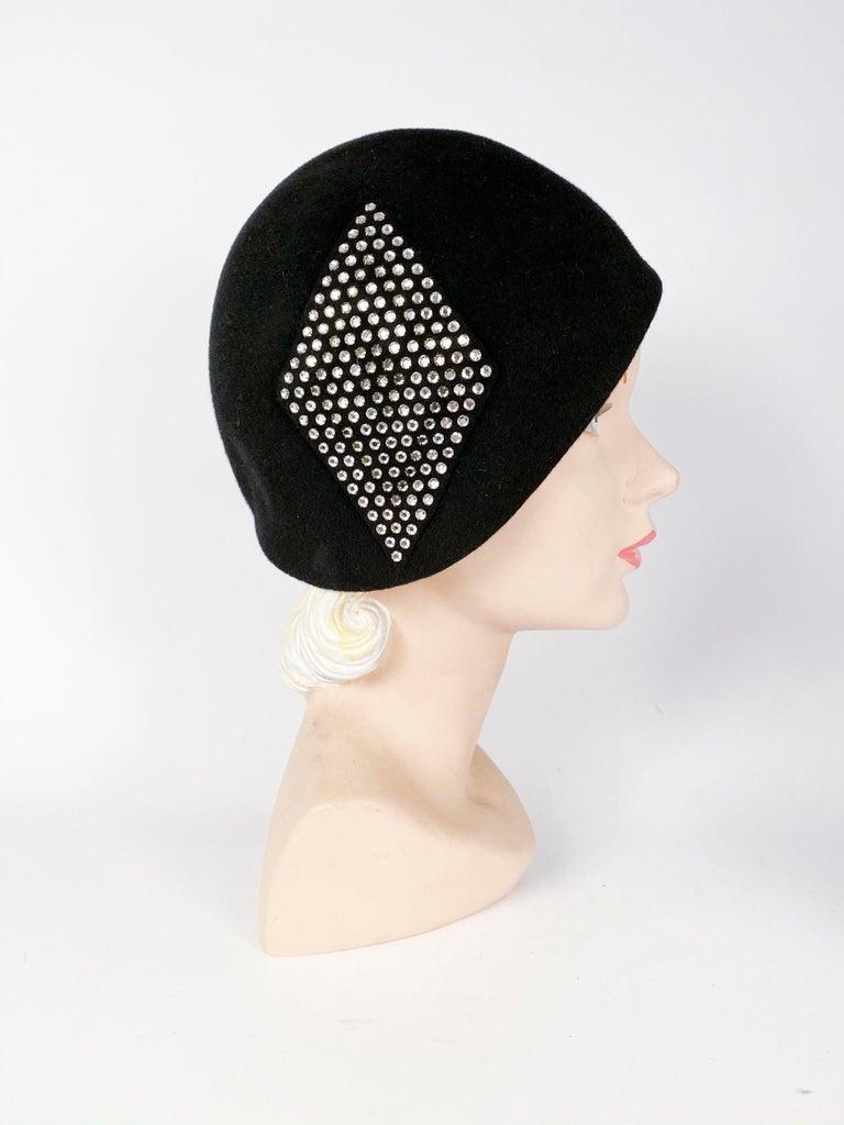 1960s black fur felt bucket hat with diamond-shaped two-tone crystal rhinestone applique.