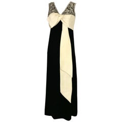 1960s Black Velvet Sleeveless Gown With Creme Silk Bow