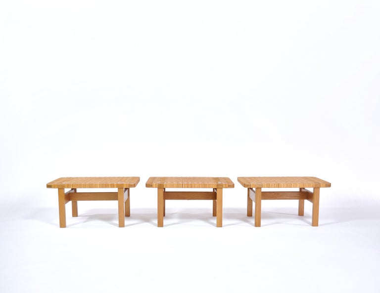 Beautiful Danish modern benches in solid oak and handwoven rattan cane by Danish architect Borge Mogensen. They can be applied both as low side tables and as benches. Mogensen made the design in the 1950s and it was made in different sizes by