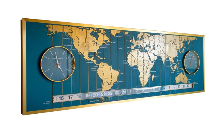 From the Braniff Place World Headquarters in Dallas, Texas comes this massive, one of a kind low-relief 9' world map. It has a functional Derby Clock on the left side and a thermometer on the right. The numerical strip at the bottom is a functional