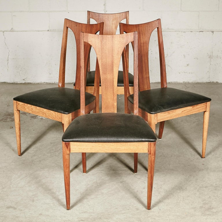Vintage 1960s set of 4 walnut wood high back Brasilia-style dining room chairs. Chairs are in newly refinished condition. Seat: 18.5in.H. No maker's mark.