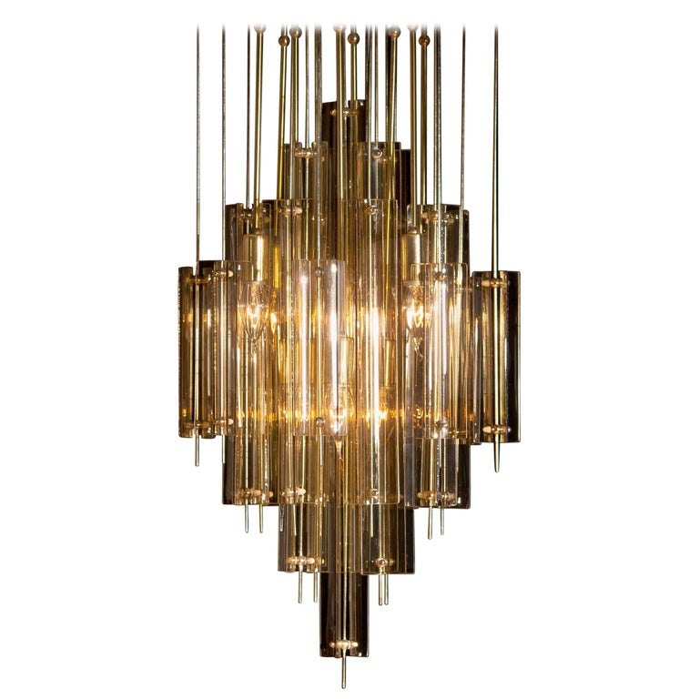 Beautiful brass chandelier by Verner Panton with smoked glass elements. Build up with eight fittings size: E14 / 17 suits 110 / 230 volts and technically 100%. Overall impression is good. Period: 1960s.