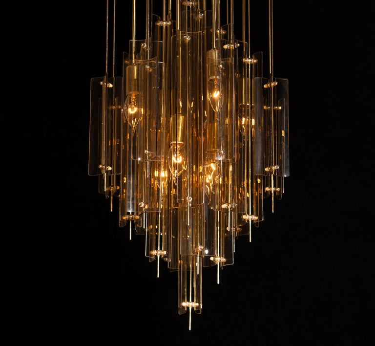 Swiss 1960s Brass Chandelier with Smoked Glass by Verner Panton For Sale