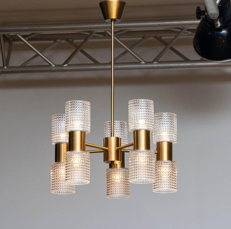 Beautiful Scandinavian chandelier by Konsthantverk Tyringe in Sweden in brass.  The user and lower lights can be, when liked, together or separately switched on / off. Technically 100% and in overall good condition. P.s. Height measurement is the