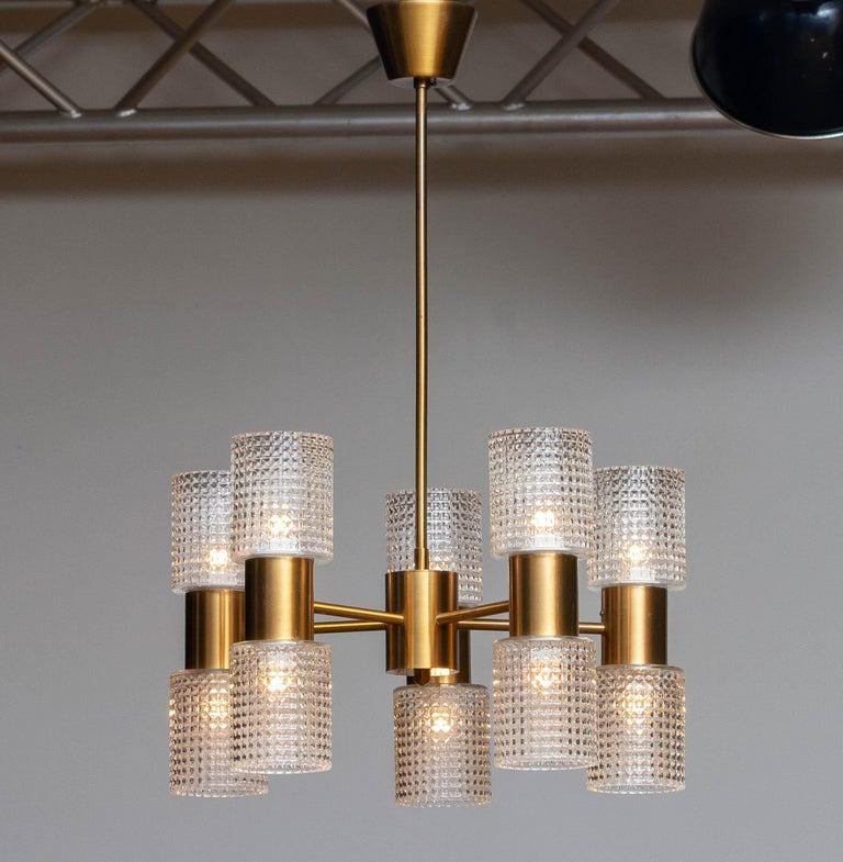 Swedish 1960's Brass Glass Up and Down Light Chandelier by Konsthantverk Tyringe, Sweden For Sale