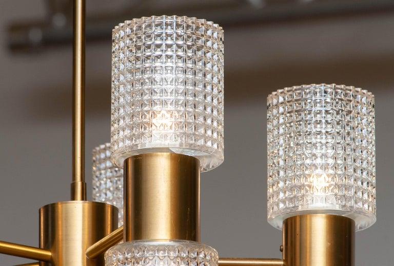 1960's Brass Glass Up and Down Light Chandelier by Konsthantverk Tyringe, Sweden In Good Condition For Sale In Silvolde, Gelderland