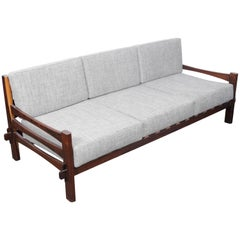 1960s Brazilian Solid Framed Rosewood and Leather Strapped Sofa