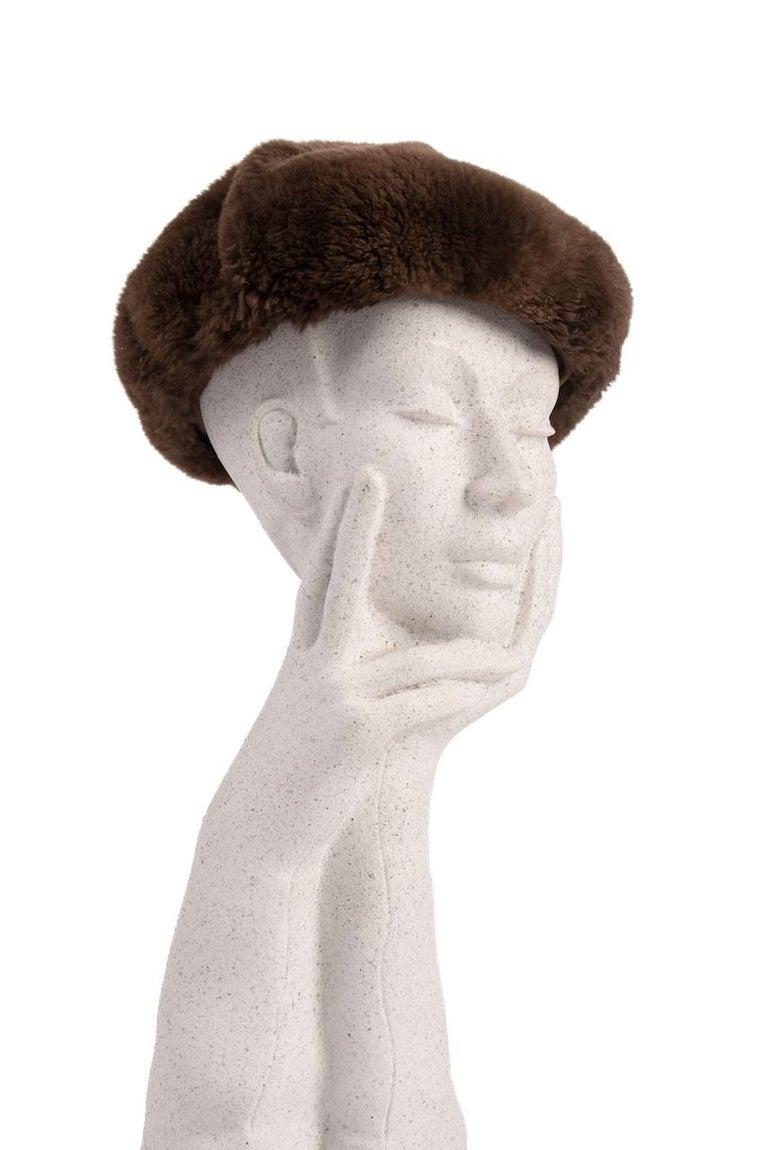 This is a chic soft, round and flat-crowned walnut brown genuine fur beret from the 1960s. It is designed from what I believe is sheared beaver fur.  Brown satin interior band and fully lined in a caramel acetate. The light-weight fur is incredibly