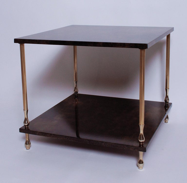 Our 1960s two-tiered brown goatskin and brass table by Aldo Tura can serve as either a coffee table or large side table.