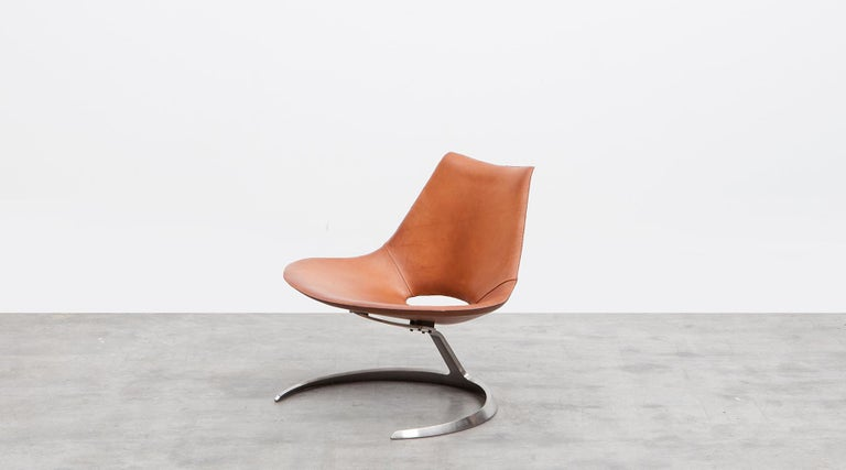 Brown leather shell on chromium plated steel base by Fabricius / Kastholm, Denmark, 1962.  1960s Design classic leather scimitar chair by the iconic Danish designer duo Fabricius / Kastholm. The Scimitar chair takes its name and its shape from the