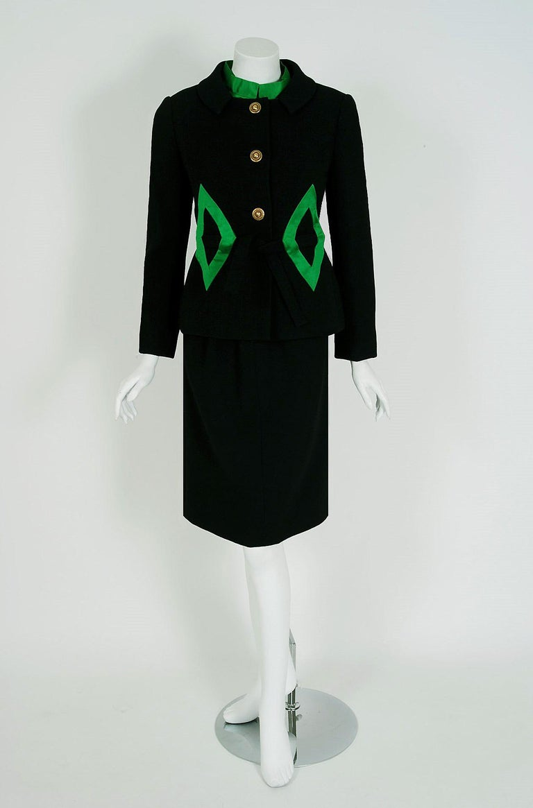 Burke-Amey was started in 1959 by designer Ronald Amey, and his business partner, Joseph Burke. Amey was known for his use of interesting materials and big, bold prints. This breathtaking black and emerald-green number is a perfect example of their