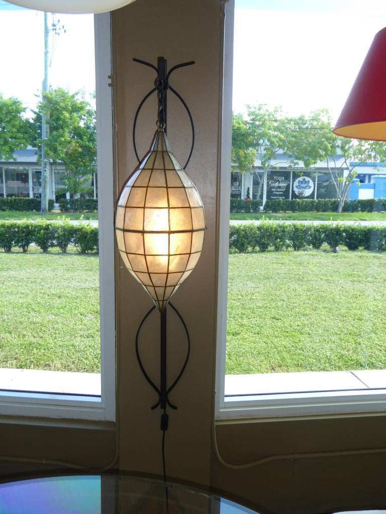 Mid-Century Modern 1960s Capiz Shell Teardrop and Wrought Iron Wall Light Sconce For Sale