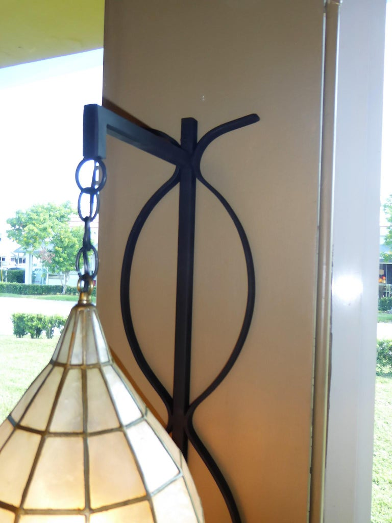 Blackened 1960s Capiz Shell Teardrop and Wrought Iron Wall Light Sconce For Sale