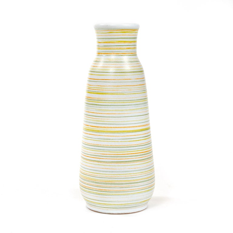 An uncommon small ceramic vase with multicolored stripes. Signed on the underside as depicted.
