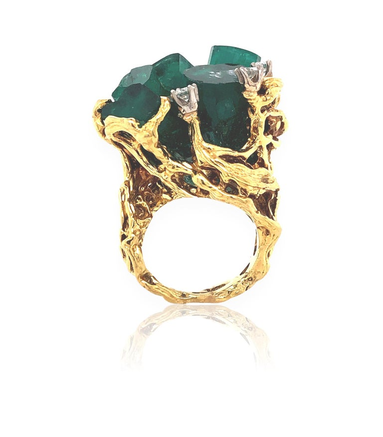 Organic rough emerald and diamond ring. The 18k  1
