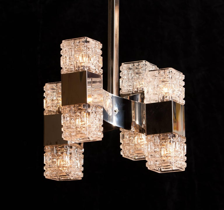Beautiful pendant light with eight light points; a wonderful example of Italian designed by Gaetano Sciolari. This lamp is made of chrome-plated steel and heavy glass. It is in a very good condition. Period 1960s Dimensions H. 82 cm, ø.35 cm.