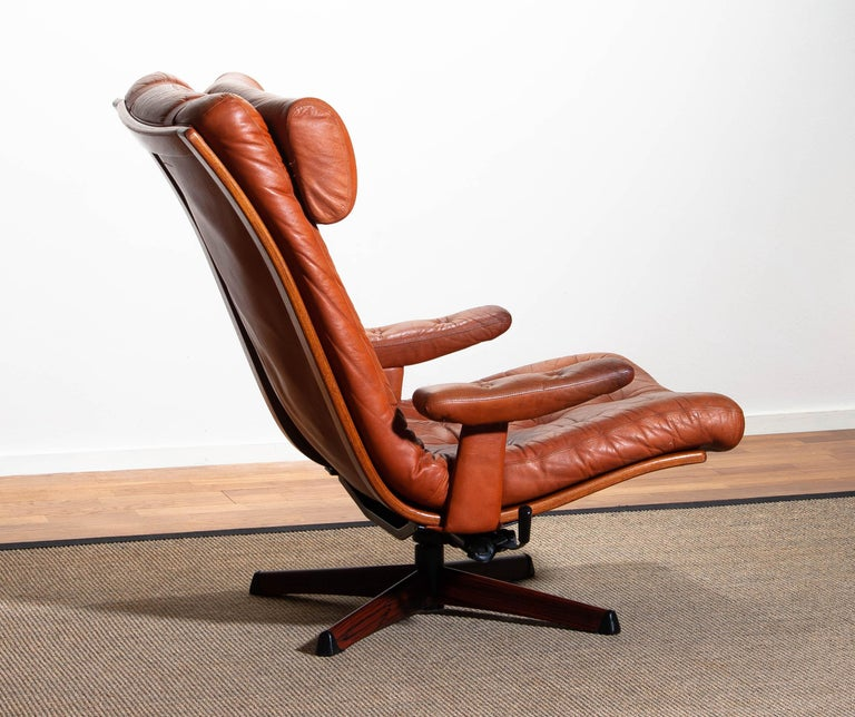 Swedish 1960s, Cognac Leather Swivel / Relax Lounge Easy Chair by Göte Design Nässjö For Sale