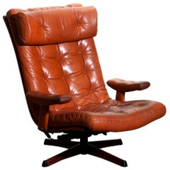 """1960s, """"Dolphin"""" Cognac Leather Swivel / Relax Lounge Easy Chair by Göte Design."""