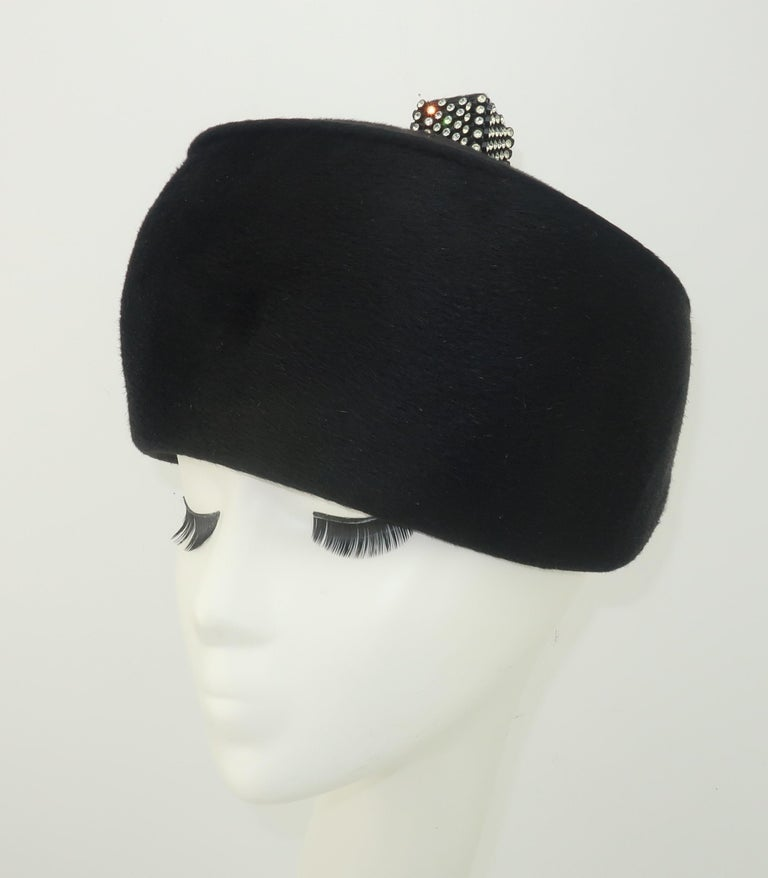 Chic black Italian mohair hat by Coralie accented by a rhinestone embellished finial.  A period perfect 1960's look that will pair well with a modern wardrobe ... day or evening. CONDITION The body of the hat is in beautiful condition.  There is the