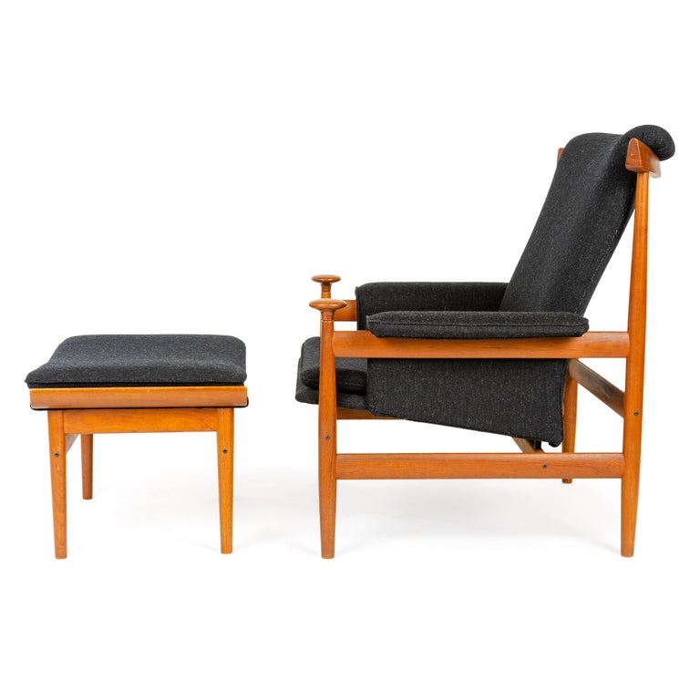 A solid teak lounge chair and ottoman designed by Finn Juhl in 1962 and produced by France & Sons in Denmark in the 1960s. Newly upholstered in black wool savak.