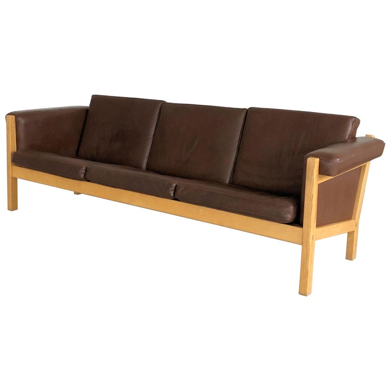 1960s Danish Hans J. Wegner Three-Seat Sofa in Oak and Brown Leather by GETAMA For Sale