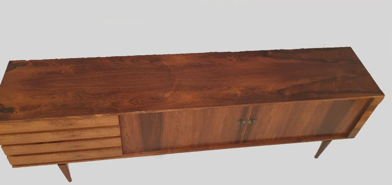 1960s Danish vintage H.W. Klein, rosewood sideboard for Bramin, with metal grips.   The spacious sideboard is designed by H.W. Klein with well balanced graphical proportions and Fine details such as the metal handles and conical tapered legs and