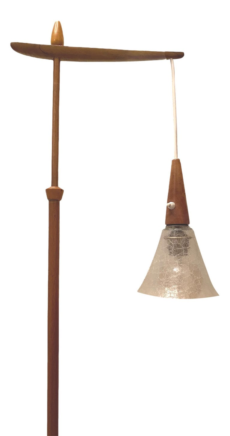 Beautiful minimalism floor lamp made in Denmark. The lamp has a nice glass shade. The wood color remains in good condition. The light is in full working order, but as with all our lighting we would always suggest it is fitted and tested by a